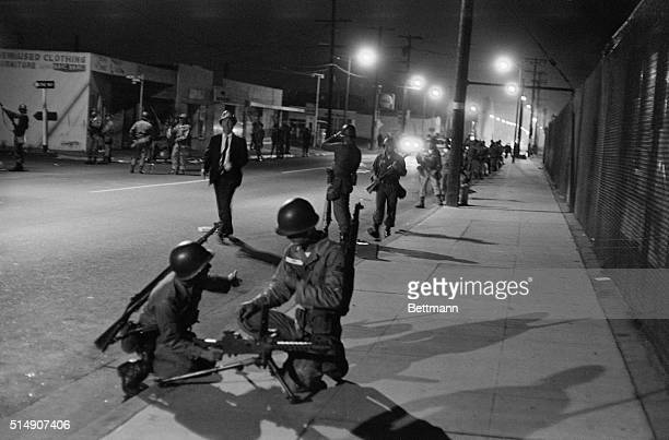 Los Angeles, CA- CA National guardsmen take up positions along the now quiet street in the west Watts section after they were called in to help quell...