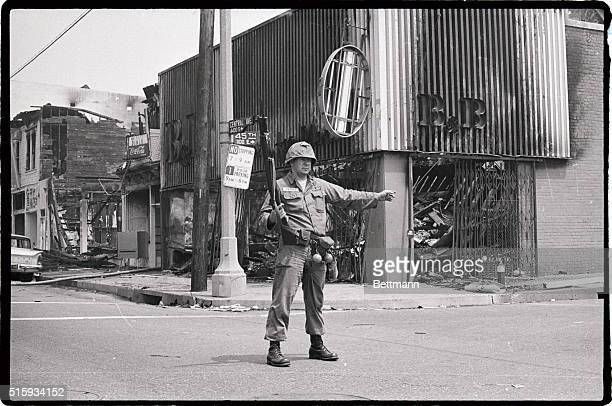 Los Angeles, CA: Photo shows a National Guardsman directing traffic on the corner of 45th and Central, as thousands of policemen and National...