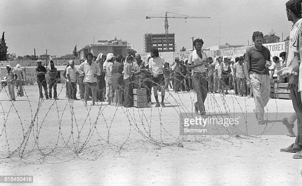 8/14/1974Limassol CyprusBehind an improvised fence of barbed wire TurkishCypriot prisoners line up for food issued to them at the Limassol Football...