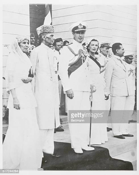 Lord Louis Mountbatten and Mohammed Ali Jinnah President of the Assembly and Governor General of the Dominion of Pakistan view a guard of honor after...