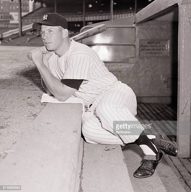 8/15/1956New York NY Yankee ace Mickey Mantle sits on the dugout steps during batting practice and seems to be pondering the big question whether or...