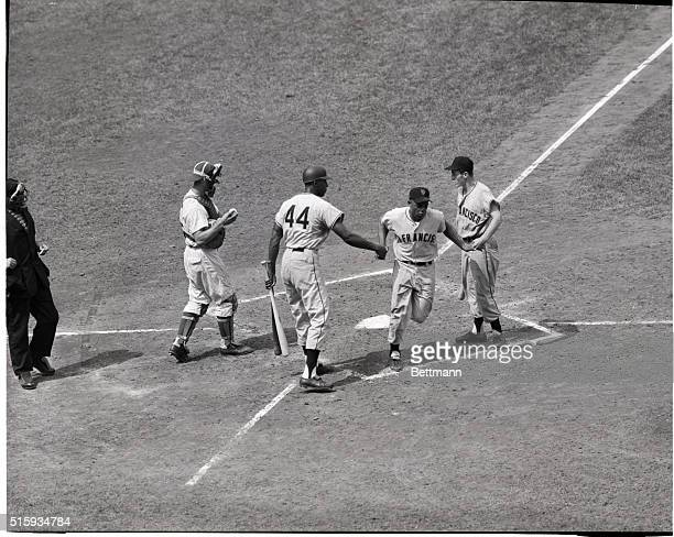 Willie Mays of the Giants crosses home plate after driving the ball over the left field wall during the third inning of the game against the Cubs at...