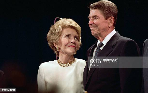 New Orleans, LA- Nancy Reagan looks up at her husband, President Reagan, with loving eyes as he makes a surprise visit to a party in Nancy's honor...