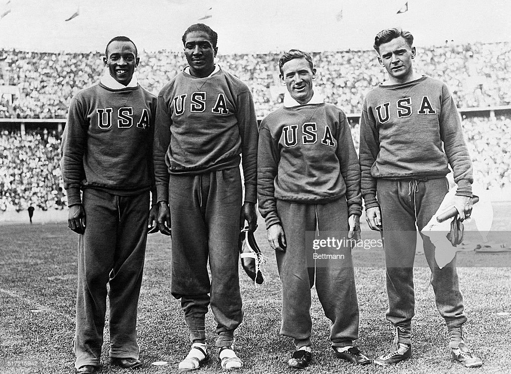 Berlin, Germany- Pictured above are the members of the American relay team which won the 400-meter relay race at the Olympics in Berin. They Bettered the world and the Olympic records at 0:39.8. Left to right: Jesse Owens, Ralph Metcalfe, Foy Draper, and Frank Wykoff.