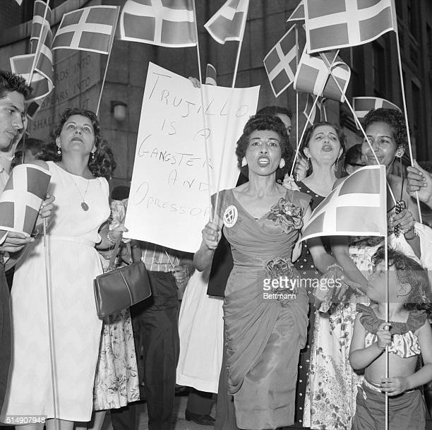 8/16/1959New York NYDemonstrators protesting against the regime of Rafael Trujillo in the Dominican Republic wave flags and hold placards in a...