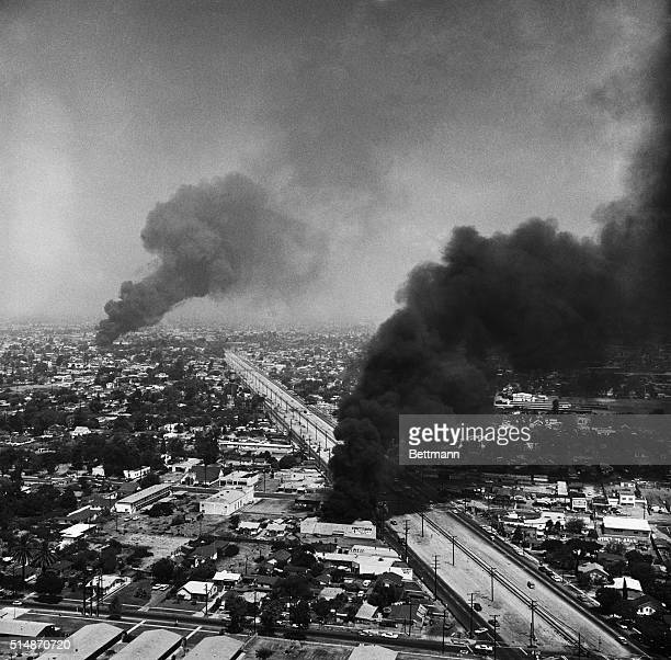Los Angeles, CA: The War In The West: Black smoke darkens the sky over Southeast Los Angeles, during the fourth day of the six day rioting in the...