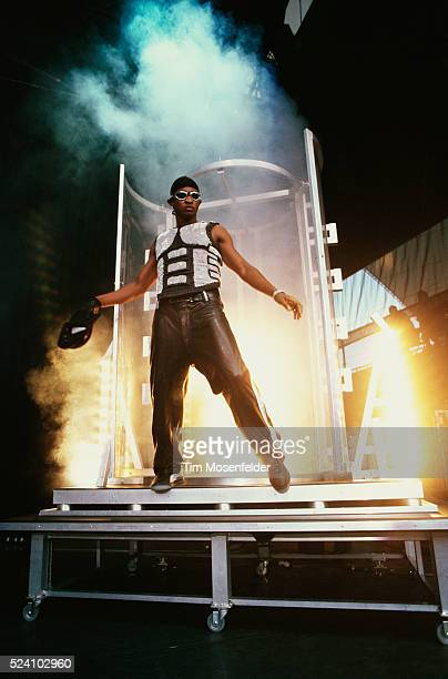 San Francisco, CA: Usher performing on stage as flames explode behind him at the Shoreline Amphitheater.