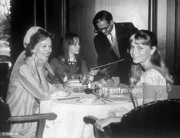 8/17/1965New York The biggest star of the recently heralded Frank Sinatra yachting party Mia Farrow enjoys a lunch with her mother Mrs John Farrow...