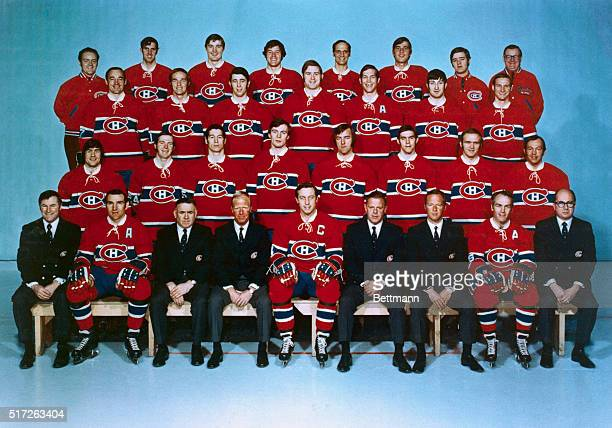 Group portrait of the 1971 Stanley Cup Champions hockey team the Montreal Canadiens Front row Al McNeil John Ferguson Sam Pollack J David Molson Jean...