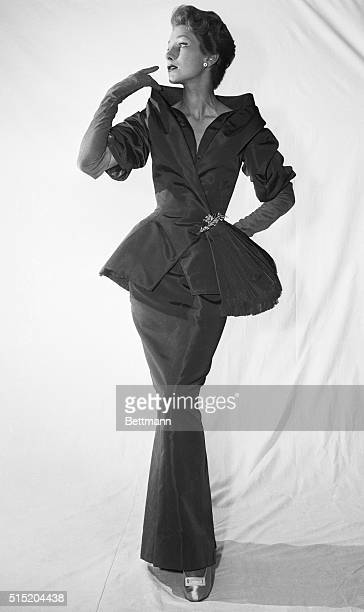 8/17/54Paris France Christian Dior's 'string bean silhouette' bulges with hip interest in a rosebeige faille evening ensemble The jacket covering a...