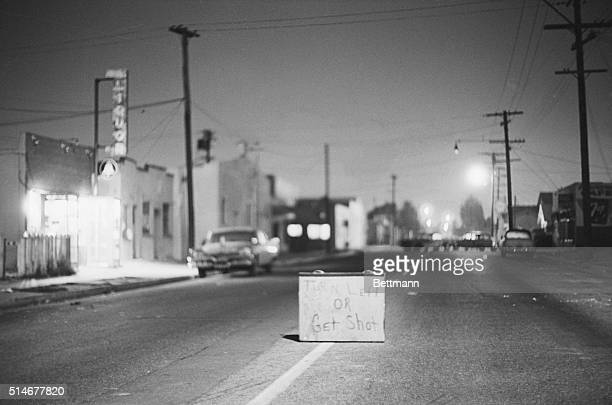 Los Angeles, CA: Although law and order have been re-established in the strife-torn Watts district of Los Angeles, this sign remains as a terrifying...
