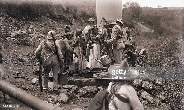 8/1914Xochimilco MexicoMembers of a Zapatista camp draw water from a well