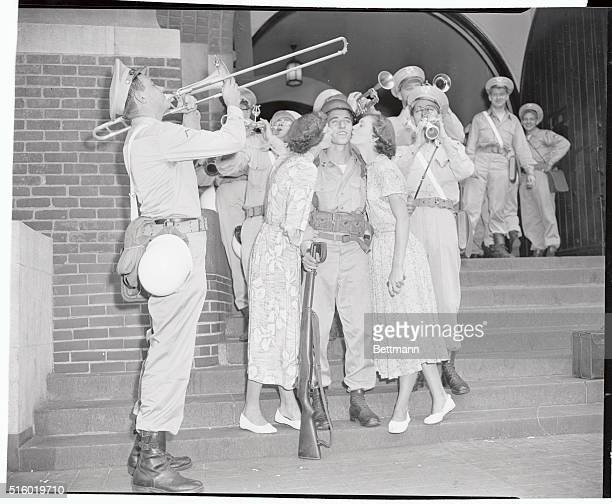 8/19/1950New York NY 165th Infantry leaving Lexington Ave and 26th St Photo shows l to r Eleanor Ennis Private Richard Hourigan and Alice Ennis The...