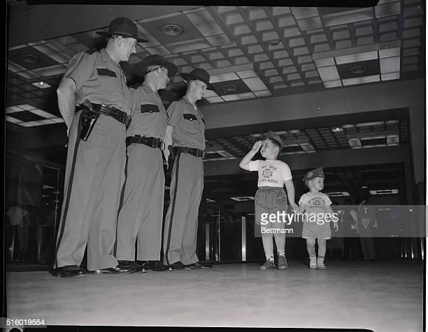 8/19/1958Trio of Indiana State Police officers get what Joey Greene intended to be a snappy salute But Joey's brother Billy 11 1/2 couldn't care less...