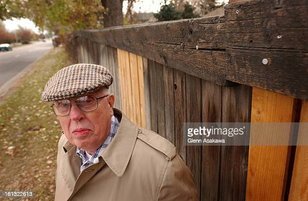 AURORA CO NOVEMBER 12 2003 81yearold Howard Jackson stands in front of a wooden fence that surrounds his neighborhood along Peoria St near E Amherst...