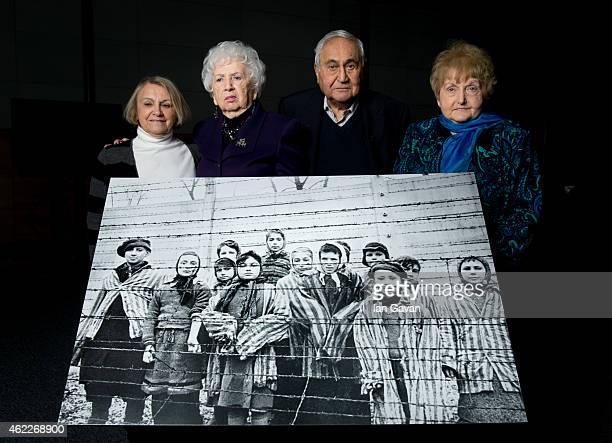 81yearold Paula Lebovics 79yearold Miriam Ziegler 85yearold Gabor Hirsch and 80yearold Eva Kor pose with the original image of them as children taken...