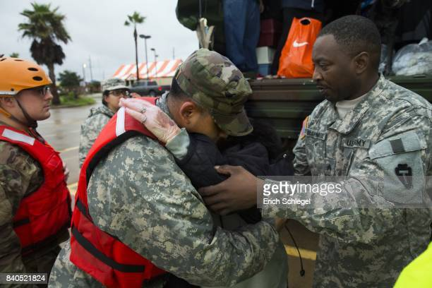 81yearold Ramona Bennett hugs Texas Army National Guard members Sergio Esquivel after she and other residents were rescued from their flooded mPine...