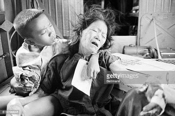 8/20/1965Chu Lai South Vietnam A Vietnamese boy comforts his wounded mother as they are flown by helicopter from their village south of Chu Lai The...