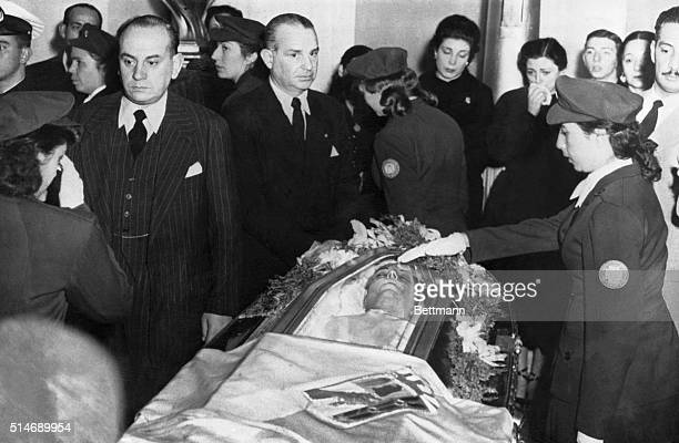 8/2/1952Buenos Aires Argentina Scores of Argentinians pass the coffin in which Eva Peron wife of the President of Argentina lie in state The girl at...