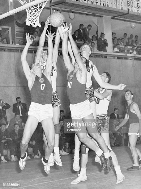 8/2/1952Helsinki Finland American cagers outreach Russian opponents around the Russian goal Aug 2 in their Olympic basketball game In action are...