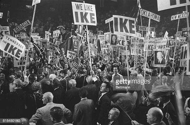 """San Francisco, California- The floor of San Francisco's Cow Palace erupts with delegates and supporters bearing """"Ike"""" signs, after President..."""