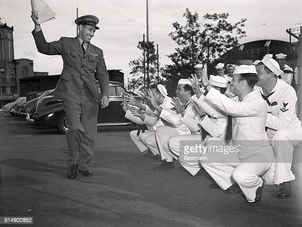 With papers placing him on the Navy's inactive list in hand Chief Specialist Bob Feller Cleveland Indian pitcher finds plenty of volunteer catchers...