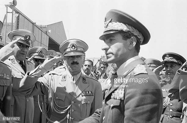8/23/1953Tehran Iran Shah Reza Pahlevi of Iran is being saluted by an honor guard upon his arrival at Teheran Airport The Shah who flew back from...