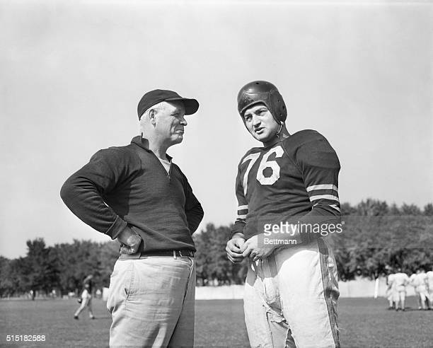 8/24/1944Collegeville IN Ensign Sid Luckman former star quarterback of the Chicago Bears who entered the Maritime Service last December talks over...