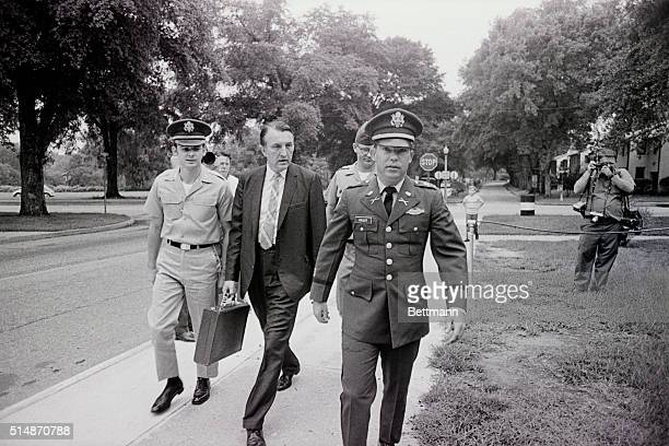 Fort Benning, GA: Lieutenant William Calley is flanked by an unidentified civilian assistant attorney and an unidentified Army escort officer as he...