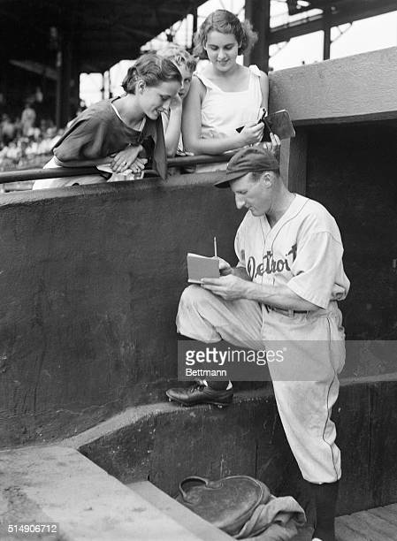 """Washington, D.C.: Leon """"Goose"""" Goslin, former Washington and now a Detroit Tiger outfielder, pictured as he autographed a baseball for one of his..."""