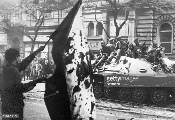 8/25/1968Prague Czechoslovakia A Czech youth displays a bloodstained flag to Soviet troops sprawled atop a passing tank in Prague August 21 the day...