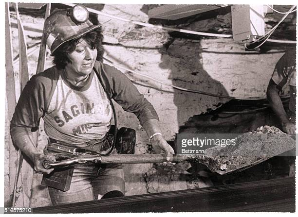 8/25/1981St Clairsville OH Linda shovels coal back on to a section of belt Mother of six and grandmother of two she's worked in the mine nearly 3 and...