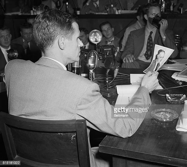 8/26/1948Washington DC Alger Hiss before the House UnAmerican Activities Committee tries to identify a photo of Whittaker Chambers as he is today...