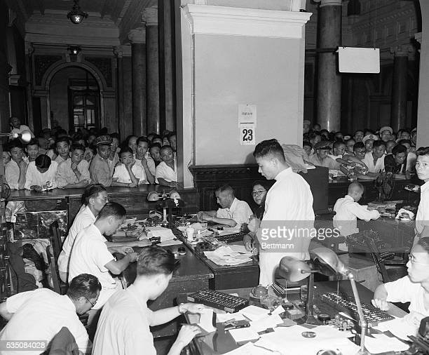 8/27/1948Shanghai China Chinese crowd bank counters to exchange their virtually worthless currency for new money The exchange was set at $3000 in old...