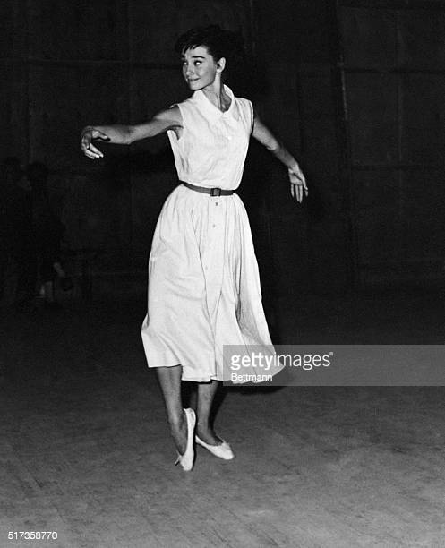 Rome, Italy- Audrey Hepburn, whose many talents didn't include the gavotte, takes lessons in the old French dance in Rome. Audrey had to learn the...