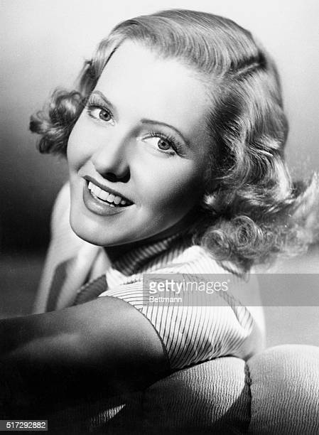 Former stage and screen actress Jean Arthur shown in this photo made in her stardom years is living a life of seclusion seldom acieved by a topflight...