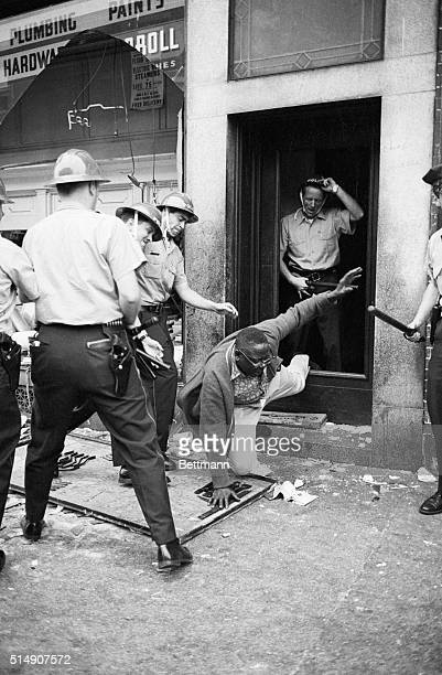8/28/1964Philadelphia PA Police flush a rioter from a building in the heart of a 1/2 square mile area which was the scene of violent disorders the...
