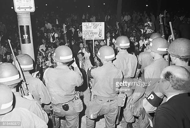 8/28/1968Chicago IL Members of the Illinois National Guard hold their positions in Grant Park despite a sign that tells them to get out and despite a...