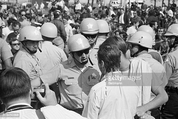 8/28/1968Chicago Illinois Helmeted police confront antiwar demonstrator bleeding from the top of his head onto his neck and shirt The demonstrators...