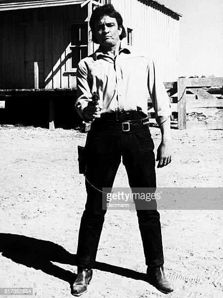 8/28/1971Santa Fe NMSinger Johnny Cash something of a cowboy himself plays a retired cowboygunman in the new Paramount picture 'Gunfight' In addition...
