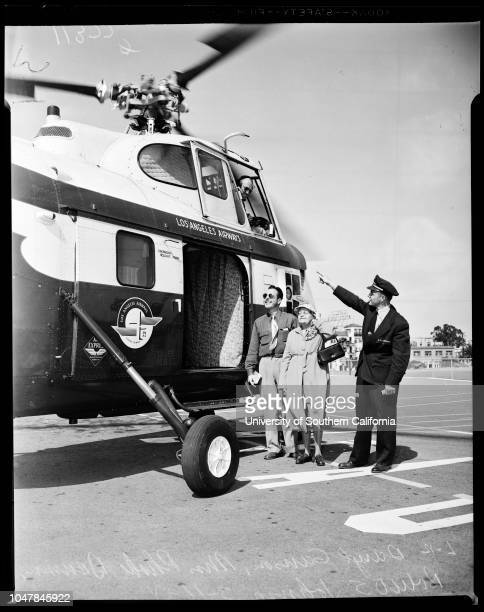 82Year woman takes helicopter hop for birthday present 16 March 1955 Mrs Phoebe Drumm 82 years Robert S Johnson Daryl Ganson 36 years Caption slip...