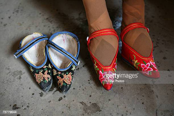 82yearold bound feet woman Fu Jifen displays Three Cuns Golden Lotus shoes she made at Liuyi Village on April 2 2007 in Tonghai County of Yunnan...