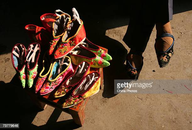 82yearold bound feet woman Fu Jifen makes Three Cuns Golden Lotus shoes at Liuyi Village on April 2 2007 in Tonghai County of Yunnan Province China...