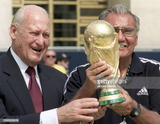 82yearold Joao Havelange departing Brazilian President of the World Soccer Federation and former Mexican goalkeeper Antonio Carbajal pose with the...