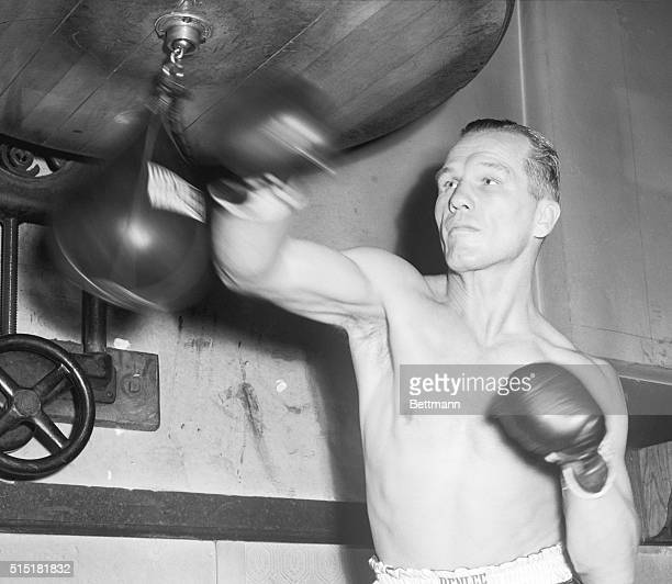 Chicago, IL- Tony Zale, middleweight champ, flays away at a little punching bag at Ringside Gym, in preparation for his title defense against Marel...