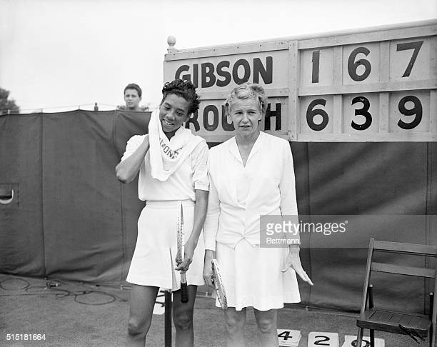 8/30/1950Forest Hills NY Wimbledon champion Louise Brough of Beverly Hills California poses with Althea Gibson of New York in front of the scoreboard...