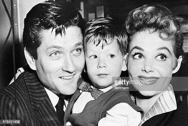 8/30/1957New York NY John Drew Barrymore scion of the Royal Family of the theater is shown with his wife actress Cara Williams and his threeyearold...