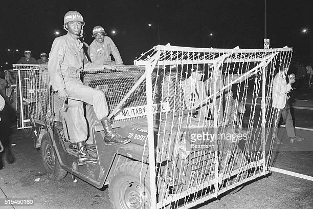8/30/1968Chicago IL Guardsmen face the camera as they stand by their riot jeeps specially built with barbed wire frames ready for action across the...