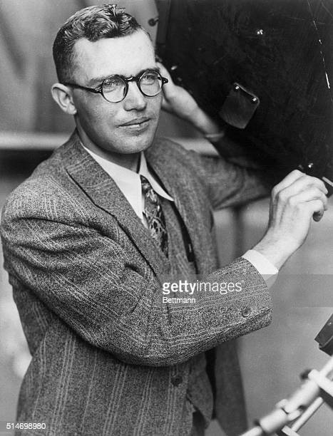Flagstaff, AZ: Clyde W. Tombaugh,. Discoverer of the planet Pluto, who is postponing his college education in order that he may be able to complete...