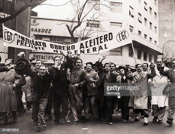 8/31/1955Buenos Aires ArgentinaWorkers shouting proPeron slogans and carrying a banner are shown on their way to the Plaza de Mayo to join a mass...